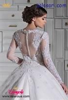 لباس عروس پفی همراه با بالاتنه کار شده و آستین بلند ترکیب زیبایی برای عروس خانم هاست