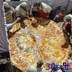 پخت بزرگترین پیتزای جهان/عکس